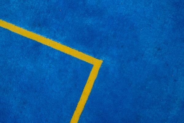 Ein blau-gelbes Basketballfeld von ChildsPlay